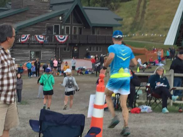 Arriving at Olympian Hall in good spirits. Mile 42. Photo Credit: Kevin Deutsche
